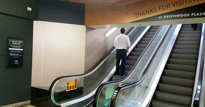 Example of parking validation display next to escalator.