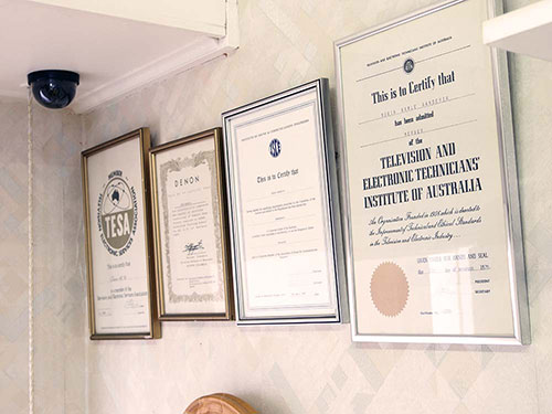 Wall mounted certificates and awards.